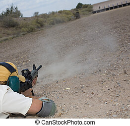 Female shooter - Woman shooting at a long distance target...