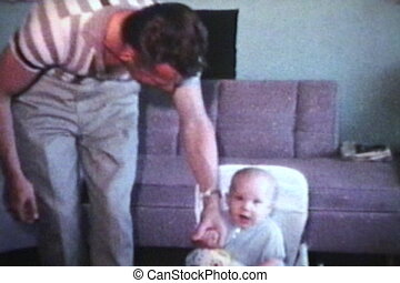 Dad Helping Baby Walk 1963 - A proud dad helps his baby boy...