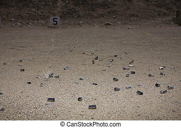 Shooting range - Empty shells that are piling up at a...