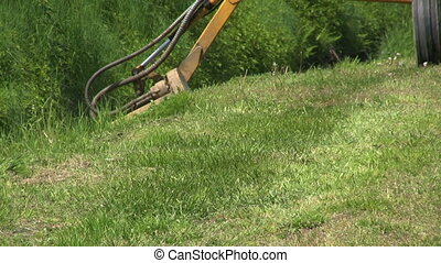 Tractor Cutting Grass In Ditch - A farmer uses his tractor...