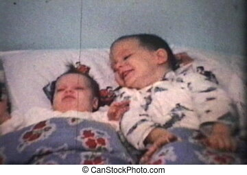 Boy Cuddles His New Sister (1965) - A proud little boy...