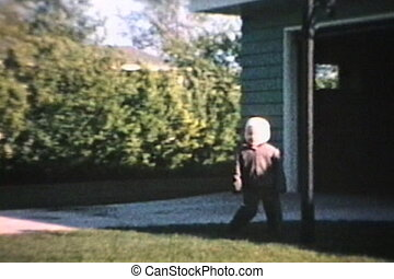 Little Boy Runs On Grass 1964 - A little boy has fun running...