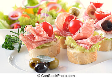 Appetizers with salami - Baguette slices with delicious...