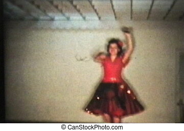 Girl Dancing With Castanettes-1958 - A pretty teenage girl...
