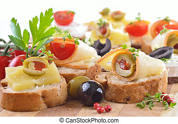 Baguette with choice of cheeses - Finger food with various...
