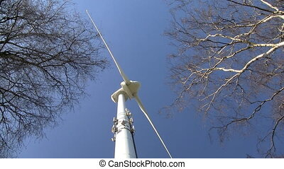Wind turbine - Rotating wind turbine in a forest