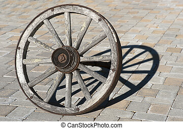 Wagon wheel - Old wagon wheel casting a shadow