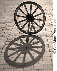 wagon wheel - Silhouette of old wooden wagon wheel