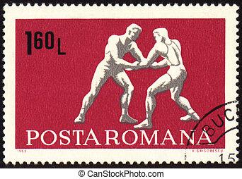 Wrestling on post stamp