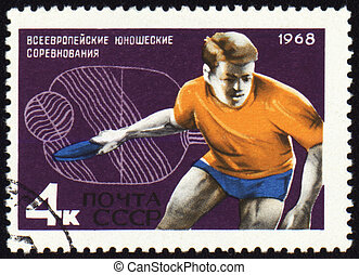 Table tennis player on post stamp