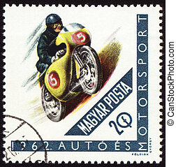 Post stamp shows motorcyclist - HUNGARY - CIRCA 1962: A...