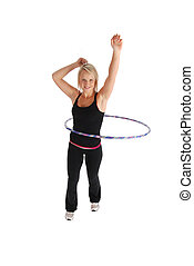 Hula Fitness - A blond woman exercising using a hula hoop