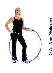 Hula Fitness - Fit blond woman holding a hula hoop, fitness...