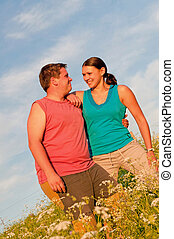 Young Couple - Young couple posing outdoor during the sunset...