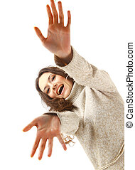 young female gesturing with hands against white background