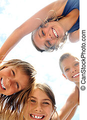 happy children - group of happy smiling kids playing...