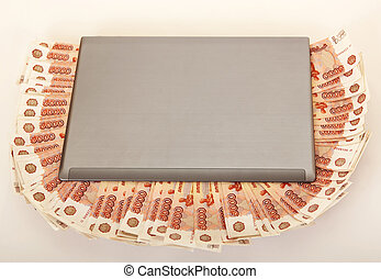 Russian big pile of money on a laptop