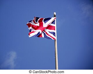 british flag in the wind on sky background