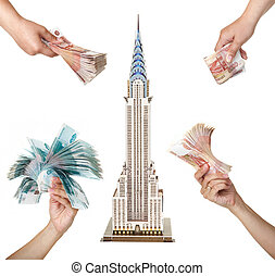 "Model skyscraper ""Chrysler Building"" and the woman's hands..."