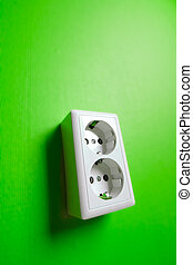 White electric socket on the wall Close up
