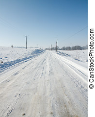 Snow covered road - Lonely mountain road covered with snow...
