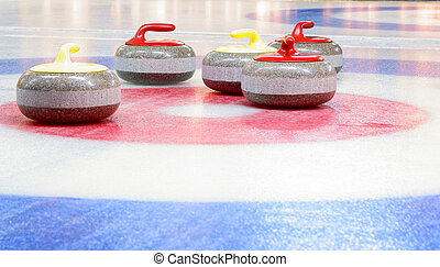 curling stones - Granite stones for curling game on the ice...