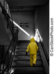 Emergency Gathering Area - Man in a yellow storm, rain gear...