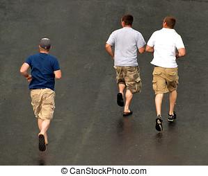 Three men running in the rain - View from above, three men...