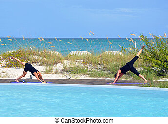 Pilates on beach over looking turquoise sea view in the...