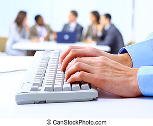 Image of male hands typing on keyboard in a working...