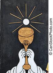 Door of church in Copan - Paint of hands holding a grail