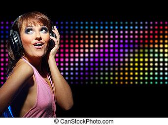 Portrait of a young dancing girl in headphones