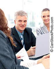 Happy successful business people in a meeting