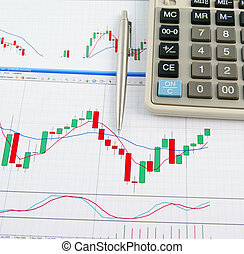 Business and Finance - Calculator and pen on the exchange...