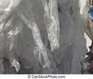 Large pressed polythene heaps prepared for recycling