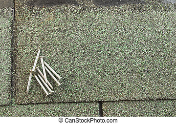 roofing nails on shingle