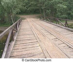 Wooden footbridge across the river