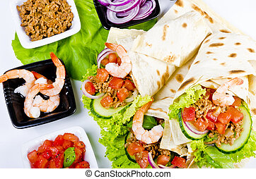 tacos - A taco is a traditional Mexican dish composed of a...