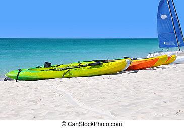 Kayaks on the beach - Colorful kayaks on the ocean beach.