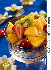 Fruit salad with strawberry, kiwi, orange and melon