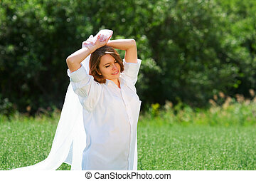 Young woman on nature