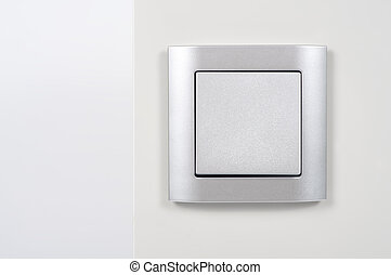 silver light switch on the wall