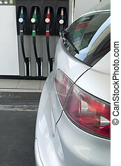 Car at a gas station - Gray car at a gas station