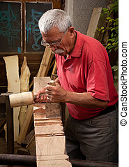 woodcarver working with mallet and chisel 3