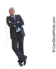 Portrait of a happy young African American business man with...