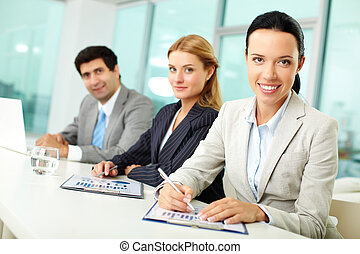 Office workers - Portrait of young woman and her colleagues...