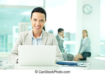 Woman working - Portrait of pretty secretary looking at...