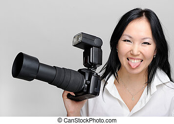 Asian woman with photo camera
