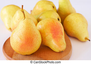 Ripe yellow pears on white background