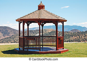 Wooden gazebo with mountain landscape in background